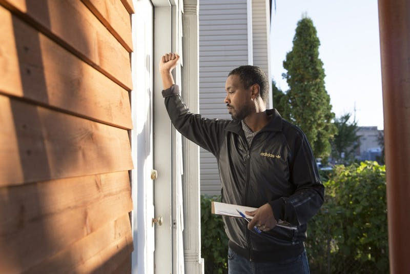 Ward 6 City Council Member Abdi Warsame knocks on doors of community members on Saturday, Oct. 14 in Minneapolis. Warsame is running for his second term as a city council member.
