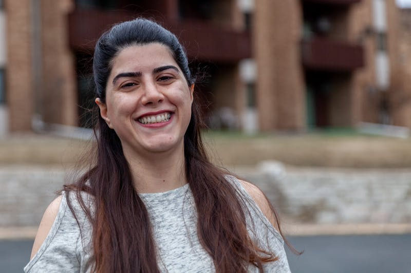 Senior Maryam Zahedi poses for a portrait at her apartment in Roseville on Saturday, March 21. The Persian New Year, traditionally celebrated with gatherings of friends and family, has been greatly impacted by restrictions on human interaction implemented in response to COVID-19.