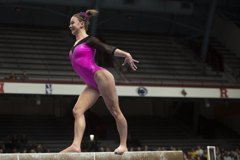 Sophomore Lexy Ramler competes on the balance beam at Maturi Pavilion on Friday, Feb 15.