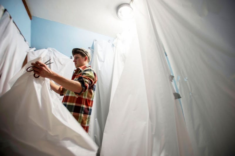 Senior James Arnason decorates his room as a part of his fraternity's haunted house at Chi Psi Wednesday evening.