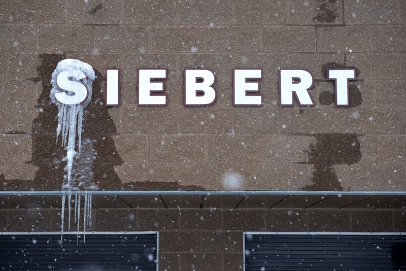The sign above the concession stand at Siebert Field gathers icicles during a blizzard on Sunday, April 15. Blizzard warnings and low temperatures have caused several sports at the University to cancel and postpone events.