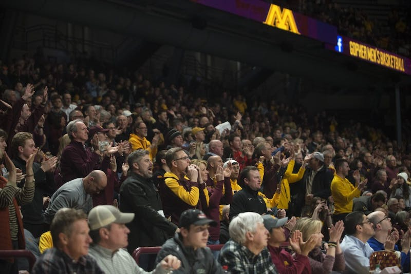 Fans cheer during the Gopher game against Purdue on Tuesday, March 5 at Williams Arena.