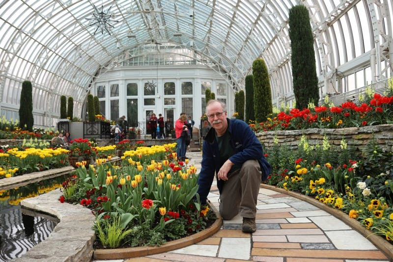 "Horticulturist Paul Knuth poses for a portrait at the Como Park Zoo & Conservatory on Thursday, April 4. ""We can grow it right here and then I can see 1,000 people coming in enjoying it, so it's very rewarding,"" Knuth said of his job at the conservatory."