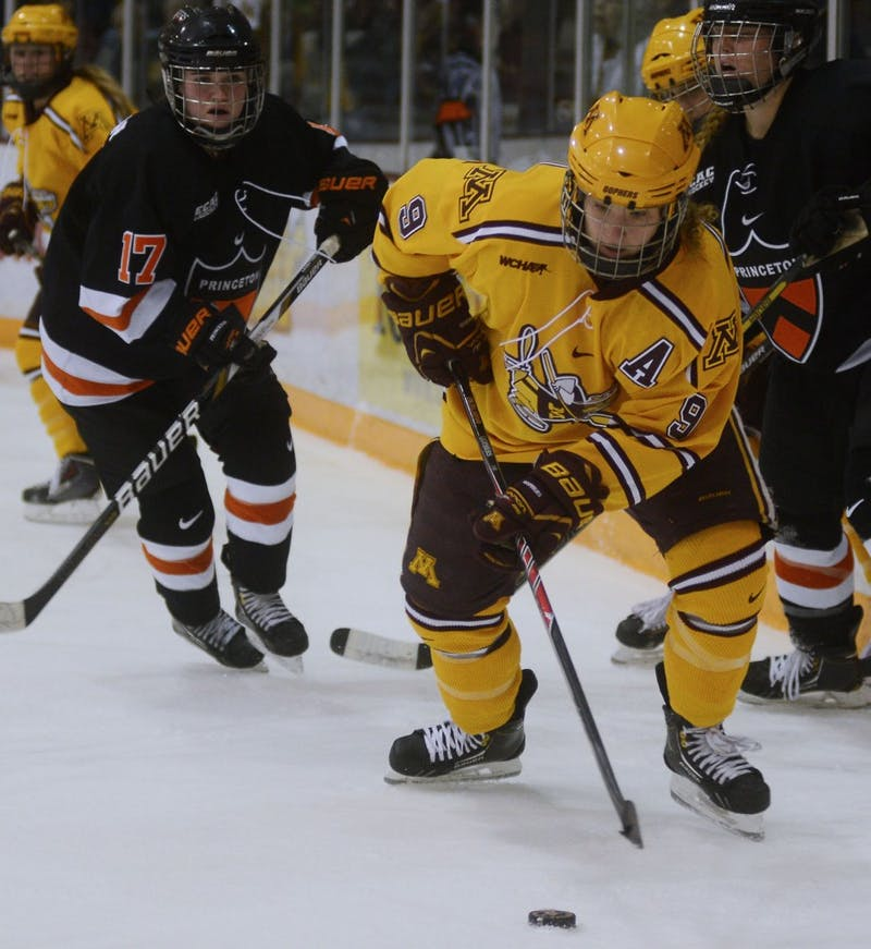 Forward Sarah Davis controls the puck at the Women's Hockey game against Princeton on Sunday.
