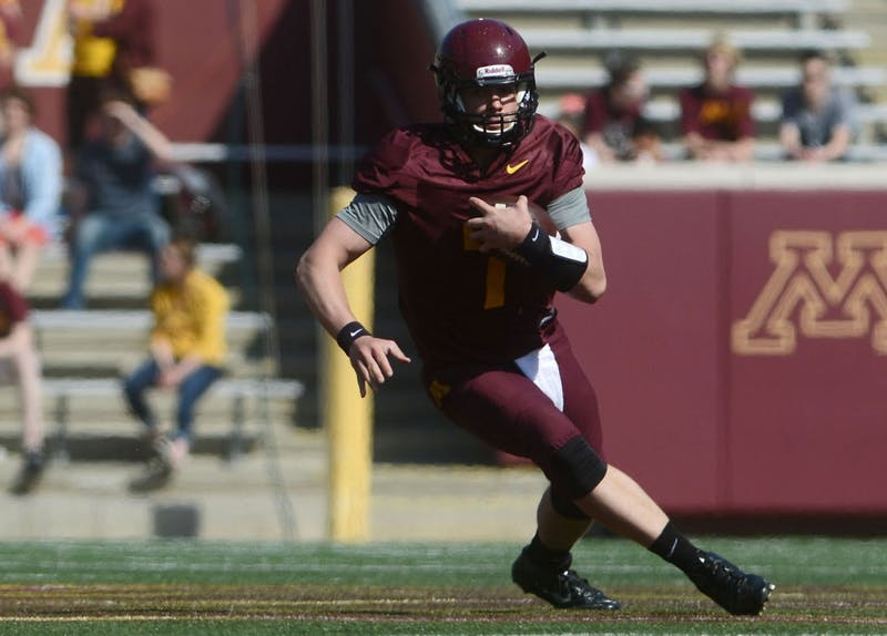 Minnesota quarterback Mitch Liedner runs the ball during the spring game on Saturday at TCF Bank Stadium.