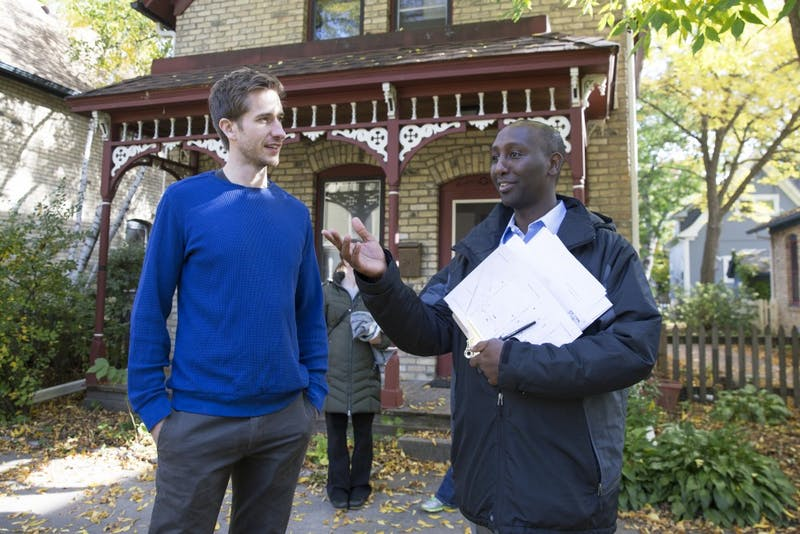 Ward 6 City Council candidate Mohamud Noor knocks on doors, speaking with Garrett Peterson outside his home on Saturday, Oct. 14 in Minneapolis. Peterson plans to vote for Noor in the upcoming election.