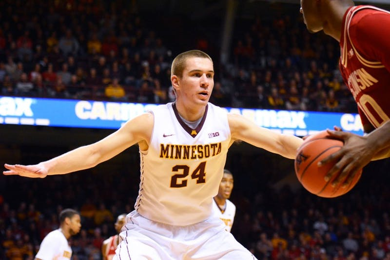 Gophers forward Joey King blocks Wisconsin during his final game in Williams Arena on Wednesday night.