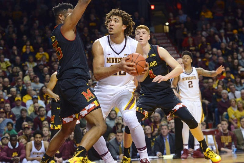 Redshirt junior Reggie Lynch looks to shoot on Jan. 28, 2017 at the Sports Pavilion.