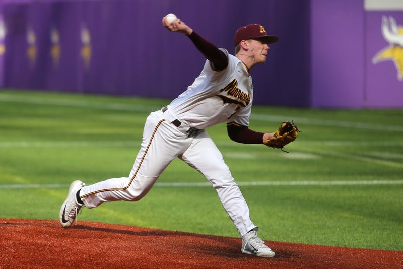 Freshman Max Meyer pitches during the game against St. John's University on March 31, 2018 at U.S. Bank Stadium.