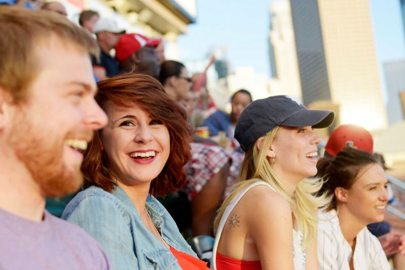 University of Minnesota graduate Lauren Feller watches a Minnesota Twins game with fellow SOBER members Lars Gunnerson, Sarah Day and Ashley Ott on Sept. 2, 2014, at Target Field.