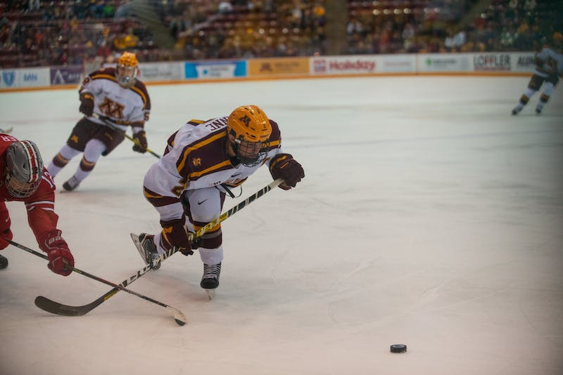 Gophers Defenseman Tyler Nanne chases the puck at 3M Arena at Mariucci on Friday, Jan. 24, 2020. The Gophers ended the night with a 6-3 victory over Ohio State.