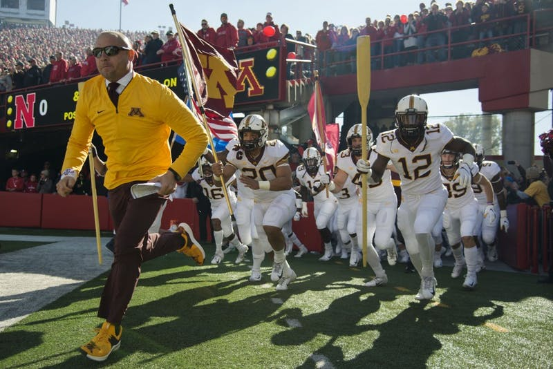 Head Coach P.J. Fleck leads the Gophers onto the field on Saturday, Oct. 20 at Memorial Stadium. Nebraska defeated the Gophers with a final score of 53-28.