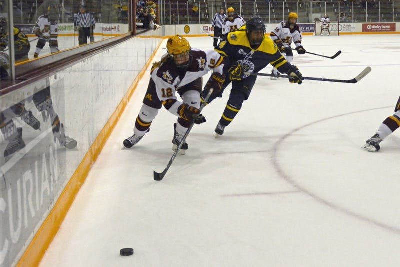Freshman forward Grace Zumwinkle chases after the puck during a game against Merrimack at Rider Arena on Sept. 29.