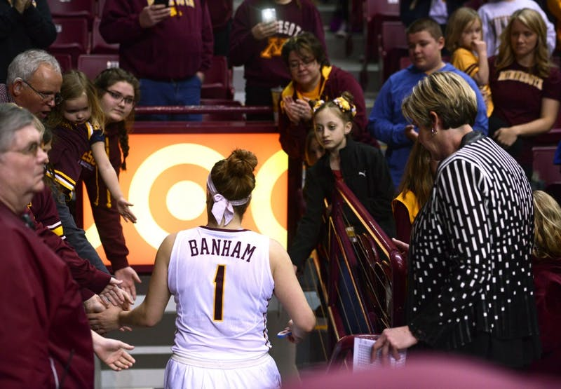 Rachel Banham gives high-fives to fans as she leaves the floor of Williams Arena for the last time. Despite Banham leading the team in scoring with 37 points,  the Gophers fell to south Dakota 101-89 in the second round of the WNIT.
