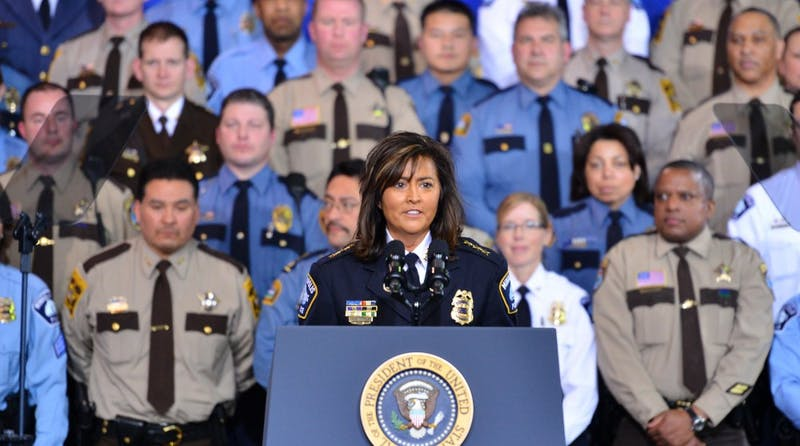 Former Minneapolis Police Chief Janee Harteau introduces President Barack Obama before his speech on gun control at the Minneapolis Police Department Special Operations Center on Feb. 5, 2013. Harteau resigned from her role on Friday in the wake of the Justine Damond shooting on Saturday, July 15.