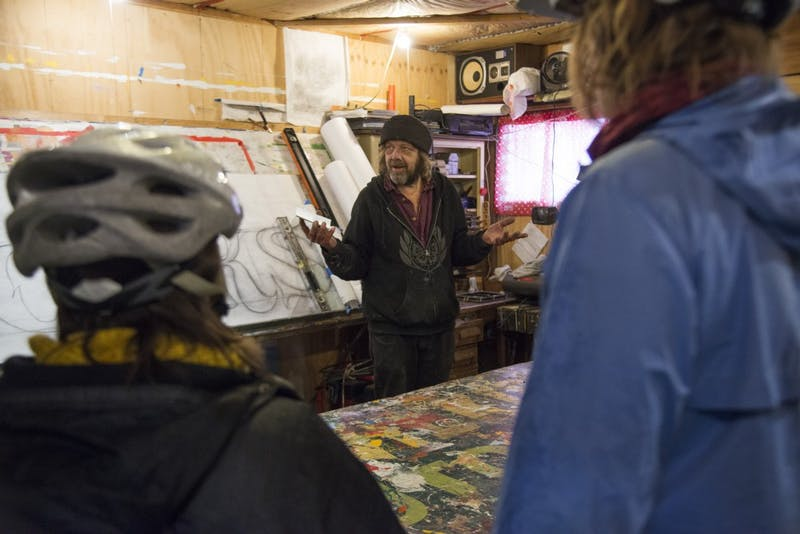 Phil Vandervaart talks about his street art before the alley ride hosted by the Minneapolis Alley Initiative for Neighborhood Stimulation on Sunday, Nov. 4. A map of the ride, which features public art in the Longfellow & Powderhorn neighborhoods, can be found online.