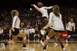 Freshman outside hitter Adanna Rollins jumps to spike the ball during the game against the Northwestern Wildcats on Saturday, Oct. 13. The Gophers beat Northwestern in all three sets.