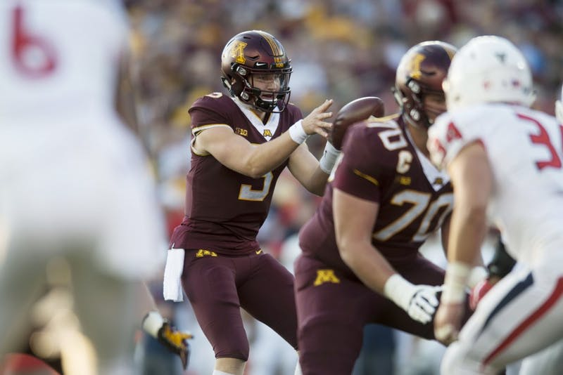 Freshman Quarterback Zack Annexstad receives the ball during the first half of the Gopher game against Fresno State on Saturday, Sept. 8 at TCF Bank Stadium.