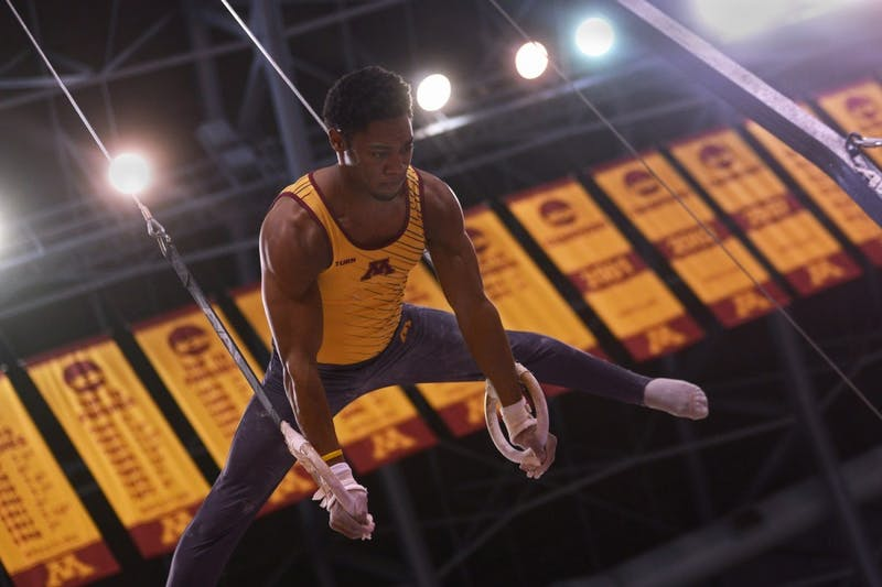 Senior Paul Montague holds a move during the still rings event Saturday at the Sports Pavilion. The Gophers scored the fourth highest team score in program history, defeating Nebraska  435.150-428.100.