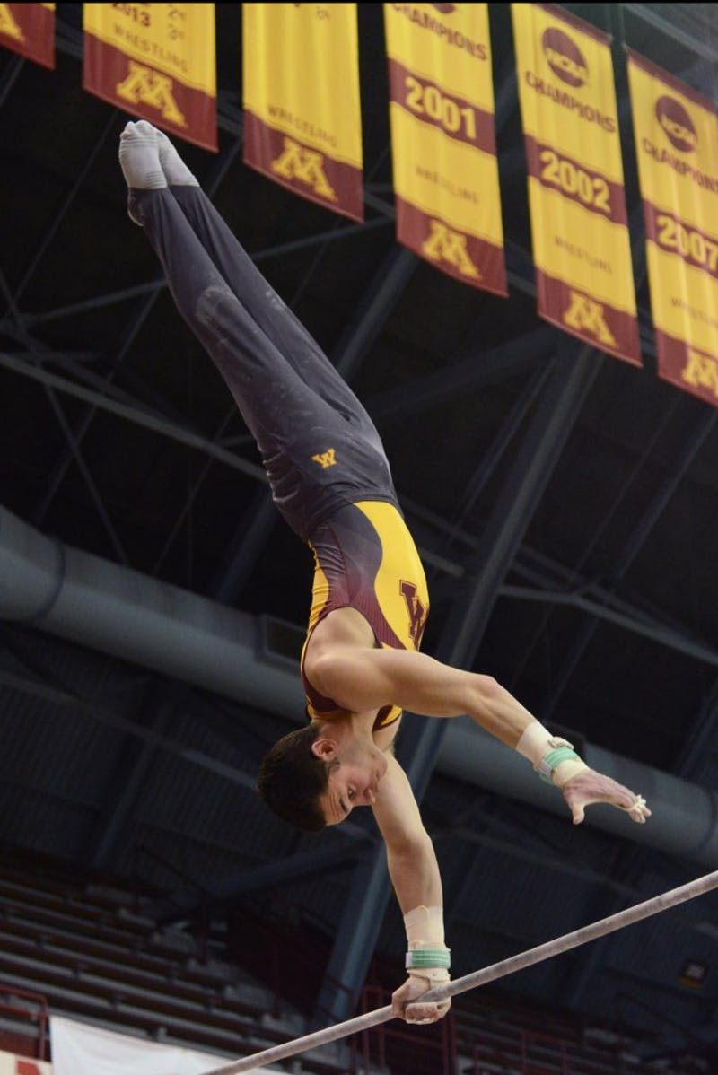 Tristan Duran competes on the high bar during the Gophers' meet against the Air Force on Jan. 21, 2017. The Gophers beat the Air Force 407.700 to 395.350.