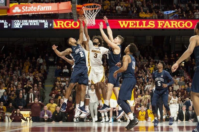 Senior forward Jordan Murphy jumps for the ball during the game against Penn State on Saturday, Jan. 19 at Williams Arena. The Gophers won 65-64.