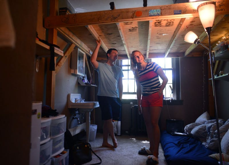 Senior political science major and sorority member Mary Carlson and president of Beta Theta Pi fraternity and senior graphic design major Nate Wong show Mary's room for the summer in the Beta Theta Pi fraternity house.