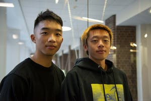 Students Stanley, left, and Dominic, right, pose for a portrait in Coffman Union on Friday, Dec. 6.