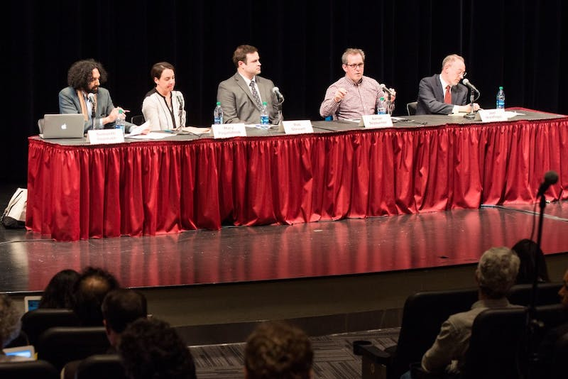 Left to right, University faculty Sumanth Gopinanth, Mary Pogatshnik, Rob Stewart, Aaron Sojourner and Joel Waldfogel speak at a community forum on faculty unionization cohosted by the Faculty Consultative Committee and the Minnesota Daily in the Coffman Theater on Monday afternoon.