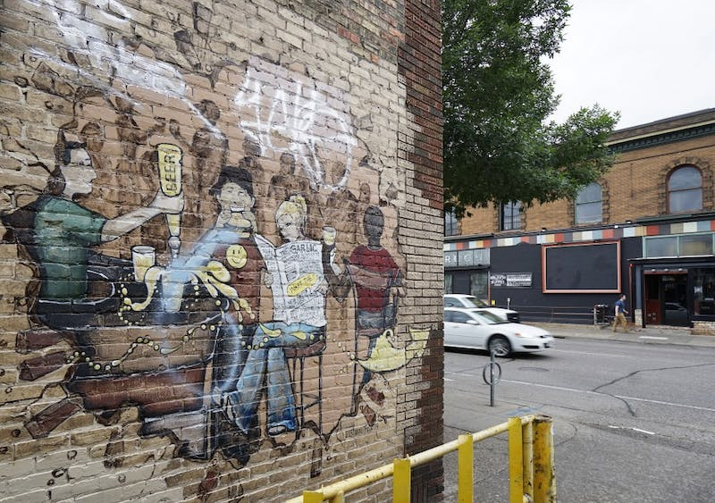 The Good Neighbor Fund, created in 2007 with money from the University, provides grants for various projects including one to preserve the murals in Dinkytown. Pictured is a mural on 4th Street SE on Monday, June 11.