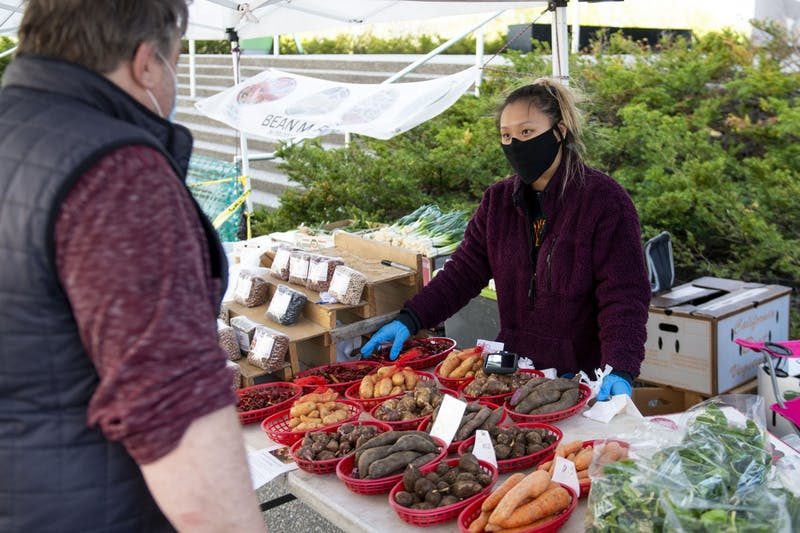 Aneedda Xiong prepares an order for a customer at the Mill City Farmers Market on Saturday, May 2.