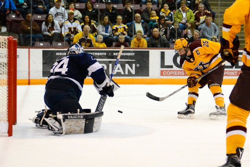 Gophers forward Justin Kloos scores a goal against Penn State at Mariucci Arena on Feb. 6.