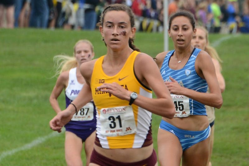 Freshman Bethany Hasz runs in the Jack Johnson Women's Gold Race at the Roy Griak Invitational on Saturday, Sept. 24, 2016 at Les Bolstad Golf Course.