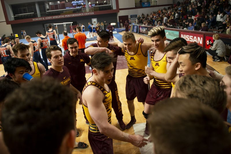 The Gophers huddle up during the meet against against the Fighting Illini at the Maturi Pavilion on Friday, Jan. 24.