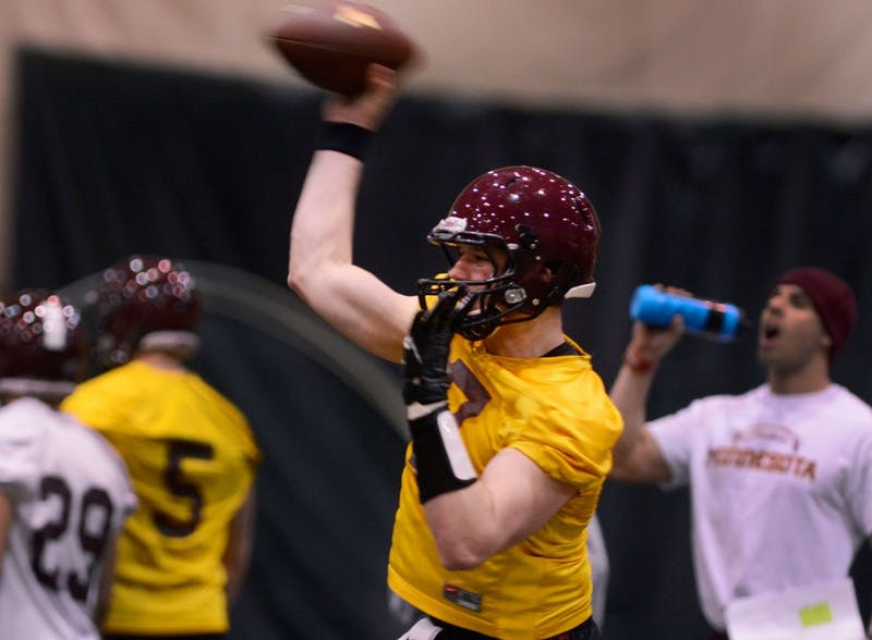 Sophomore starting quarterback Mitch Leidner throws the ball during their first practice of spring season at Bierman Field Athletic Building on Tuesday.