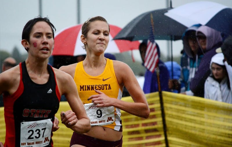 Minnesota senior Laura Docherty finishes behind North Carolina State's Joanna Thompson in the women's Division I Roy Griak Invitational on Saturday at Les Bolstad Golf Course.