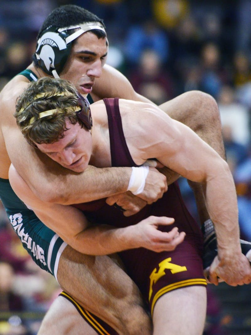 Minnesota's Kevin Steinhaus tries to take down Michigan State's John Rizqallah on Sunday, Feb. 3, 2013, at the Sports Pavilion.