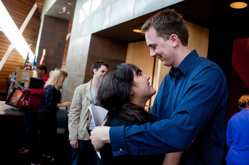 Scott Deeney embraces his wife Sarah after learning his match for his residency program Friday at McNamara Alumni Center. Deeney will be going to the University of Colorado Denver and focusing in surgery.