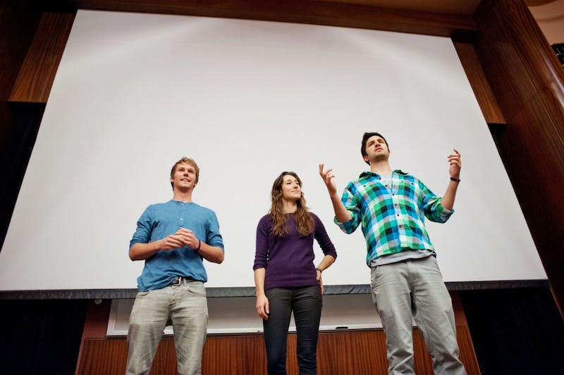 """Chris Temple, Hannah Gregg and Zach Ingrasci prepare to present their film, """"Living on One Dollar,"""" on Sunday night at the Bell Museum of Natural History. Temple and Ingrasci, graduates of Claremont McKenna College in California, produced the film about their experiences of living on less than a dollar a day for two months in Guatemala."""
