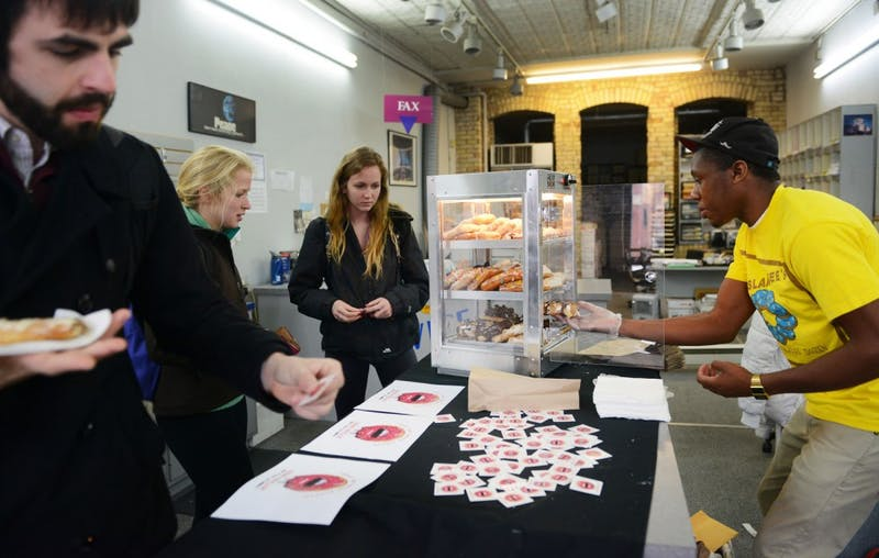 University graduate Bradley Taylor, founder of pop-up donut shop Sssdude-Nutz, sells donuts at Alpha Print Inc. in Dinkytown on Wednesday. Taylor makes the donuts himself and sells them in various pop-up locations around Minneapolis.
