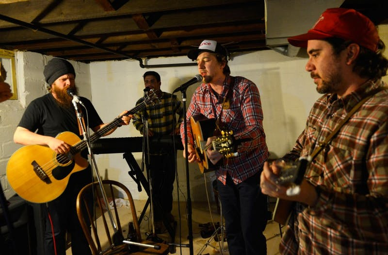 Members of local bluegrass band Thirsty River rehearse in Minneapolis on Wednesday. The band will be performing at their CD release show at Icehouse on Friday, April 17.