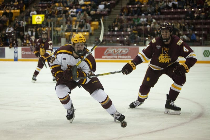 Forward Ben Meyers chases the puck at the 3M Arena at Mariucci on Friday, Oct. 25. The Gophers went on to lose 2-5 to the University of Minnesota Duluth.