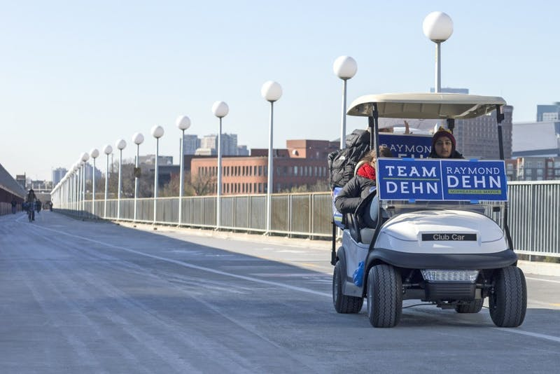 Campaigners for Raymond Dehn, senior Sonia Neculescu and sophomore Aisha Chughtai, offer rides across the Washington Avenue Bridge on Tuesday, Nov. 7.