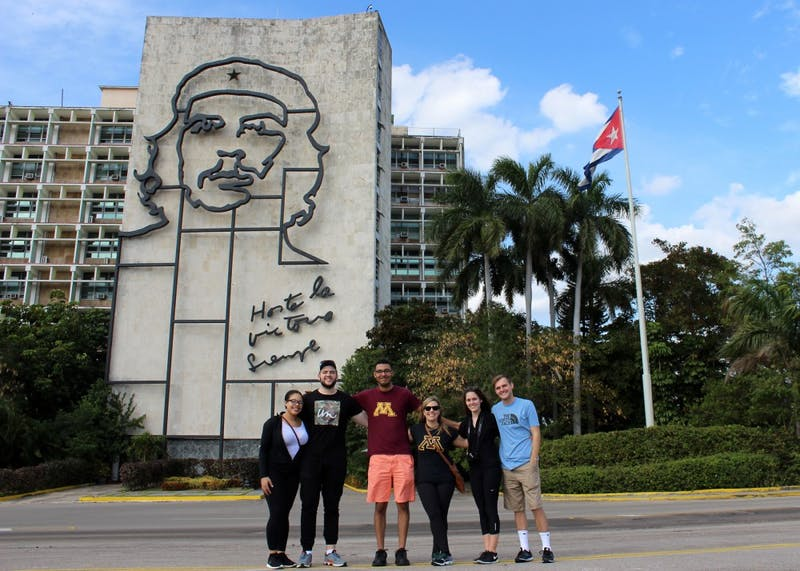 Carlson School of Management students pose in front of Che Guevara's image at the Plaza de la Revolución in Havana, Cuba over spring break as a part of a University course, Introduction to Entrepreneurship, which allows students to pitch ideas to foreign businesses.
