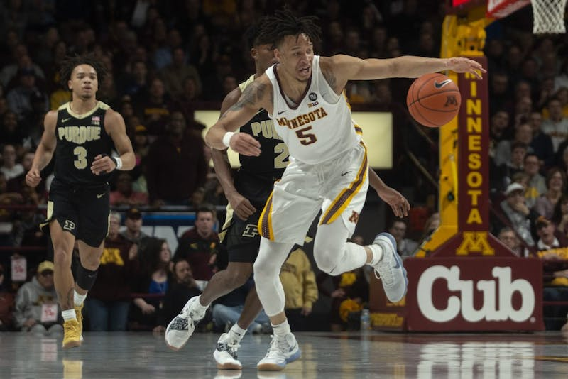 Junior Amir Coffey fights to control the ball on Tuesday, March 5 at Williams Arena.