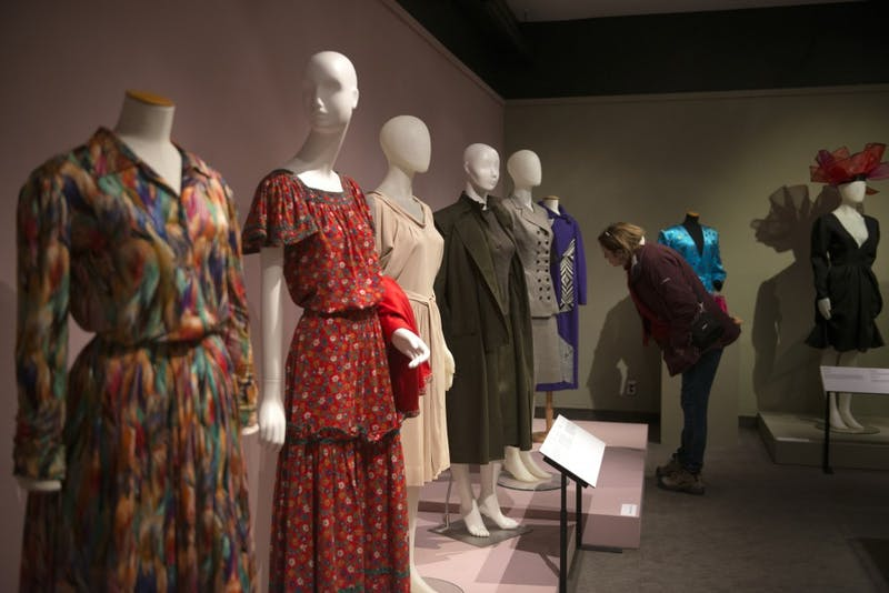 """The exhibition """"Women and their Wardrobes: Storied Lives"""" opened at the Goldstein Gallery on Friday, Jan. 26. The exhibit showcases pieces from the wardrobes of three women with prominent careers in the Twin Cities, and explores their motivation behind wearing such lavish garments."""