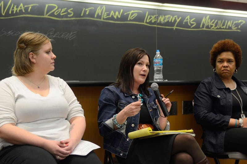 Panelist Lindsay Gullingsrud, center, discusses masculinity at the Tate Lab of Physics on April 14, 2015, as part of an event to help the campus community understand what may cause sexual violence.