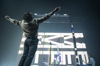 Matty Healy of The 1975 listened to the music as he came on stage on Tuesday, May 7 at The Armory in Minneapolis. The 1975 played a sold out show.