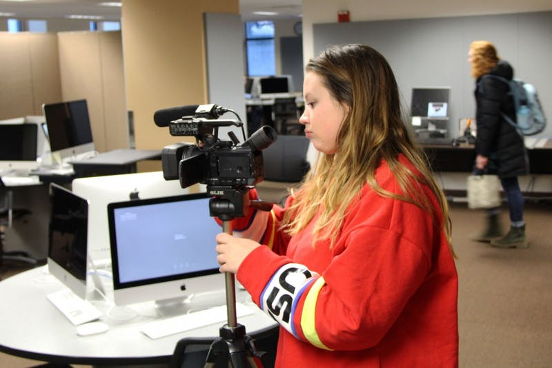 Kayla Finnerty sets up her camera on Wednesday, Feb. 19 in Murphy Hall. Finnerty is required to shoot video on campus for coursework in her digital content development and production for brand communications class.