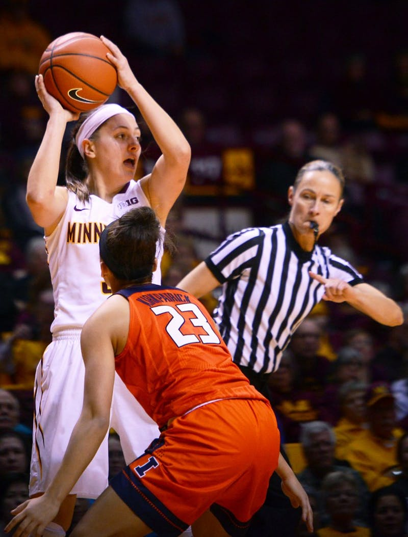 Senior Shayne Mullaney faces pressure from Illinois defense at Williams Arena on Tuesday, Jan. 26.