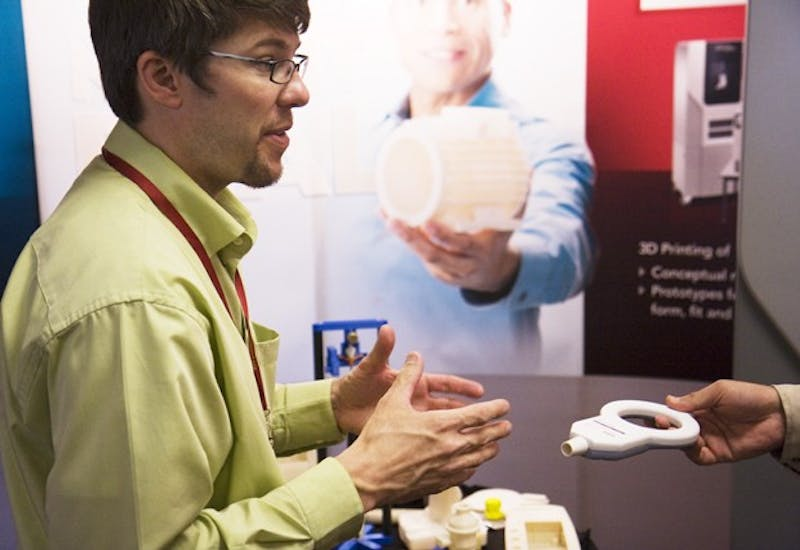 Matt Havekost of Stratasys explains how a 3D printer makes intricate prototypes to a conference attendee at the 2010 Design and Medical Devices Conference on Wednesday.